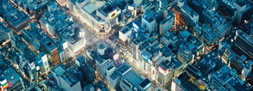 Aerial shot of a junction with skyscrapers in Tokyo, Japan.